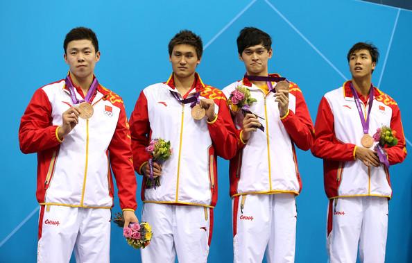 Китай (слева-направо: Хао Юнь, Ли Юнчи, Сунь Ян, Цзянь Хайци)
